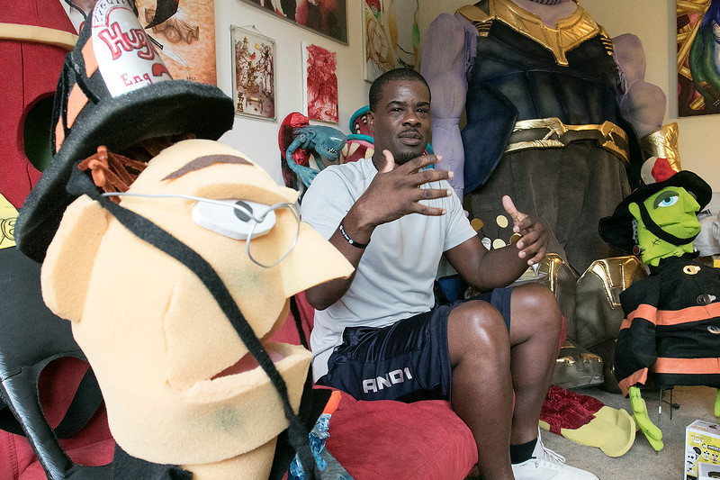 Fitchburg Firefighter Yona Vaughan talks about his life and his creations while he is surround by the costumes he makes and his four self published books at his home in Leominster Friday, September 6, 2019. SENTINEL & ENTERPRISE/JOHN LOVE