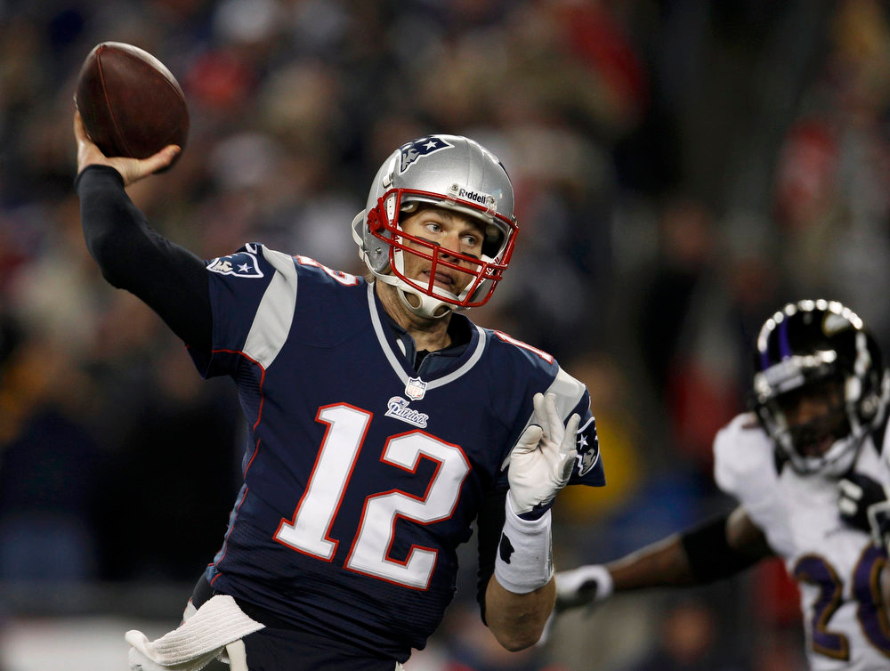 Description of . New England Patriots quarterback Tom Brady passes for a first half touchdown to wide receiver Wes Welker (not shown) during the NFL AFC Championship football game against the Baltimore Ravens in Foxborough, Massachusetts, January 20, 2013.  REUTERS/Adam Hunger