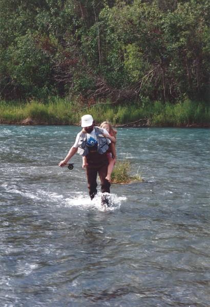 Jeff fishing and carrying Devon.jpeg