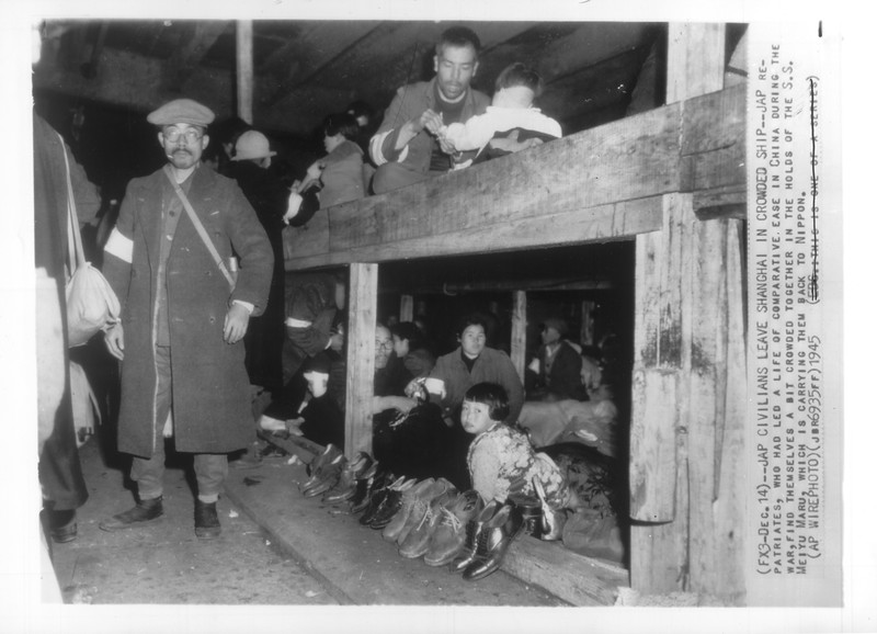 """""""Jap Civilians Leave Shanghai in Crowded Ship"""" -- caption on photograph"""
