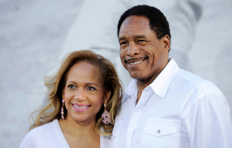 """. Former Major League Baseball player Dave Winfield poses with his wife Tonya Turner at the Los Angeles premiere of \""""42\"""" at the TCL Chinese Theater on Tuesday, April 9, 2013 in Los Angeles. (Photo by Chris Pizzello/Invision/AP)"""