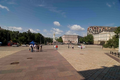 Kiev has many large town squares, on the right the roof of a building is being reconstructed with a copper lining