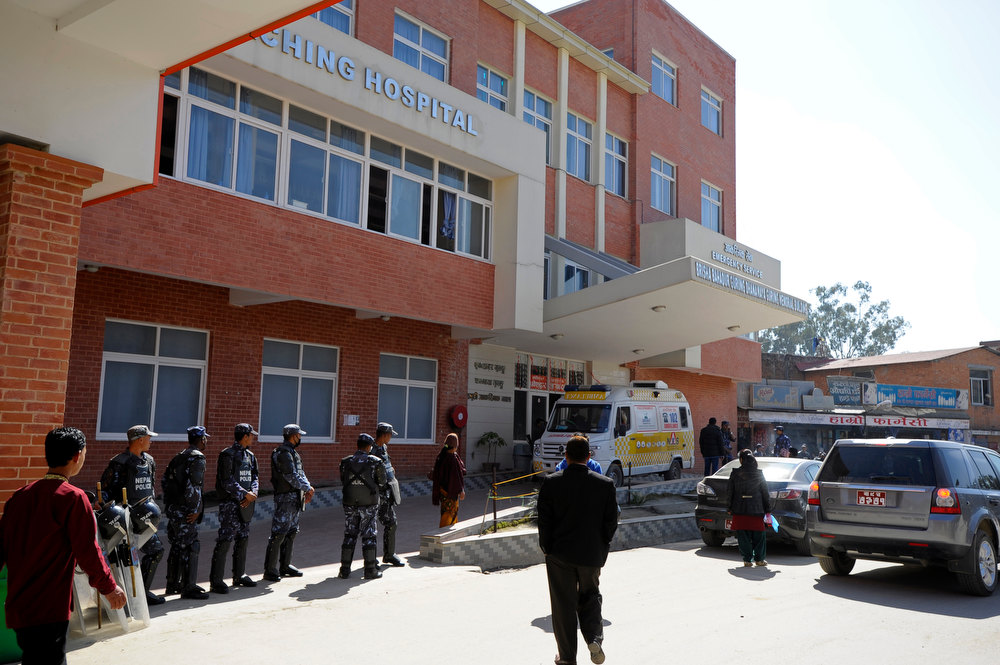 . Nepalese police stand guard outside a hospital where a Tibetan Buddhist monk is receiving treatment after he self-immolated in Kathmandu on February 13, 2013. A Tibetan monk doused himself in petrol in a Kathmandu restaurant on Wednesday and set himself on fire, marking the 100th self-immolation bid in a wave of protests against Chinese rule since 2009. PRAKASH MATHEMA/AFP/Getty Images