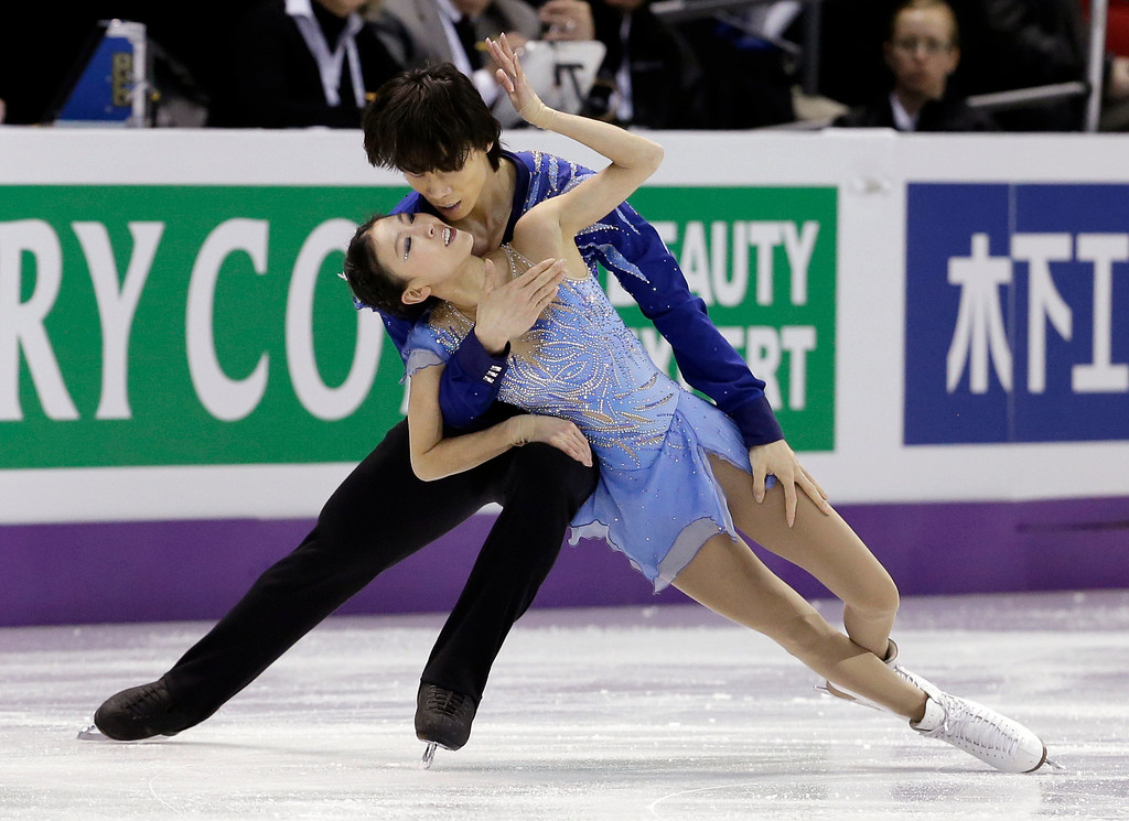 . Pang Qing and Tong Jian, of China, perform during the pairs free program at the World Figure Skating Championships Friday, March 15, 2013, in London, Ontario. (AP Photo/Darron Cummings)
