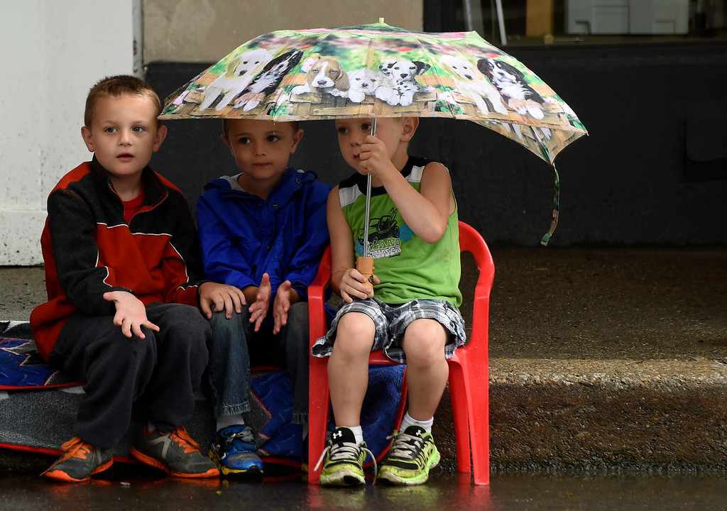 . (L-R) Connor Buker, 8,  Bradon Hall, 5, and Jacob Buker, 5, of Brattleboro wait for the Brattleboro Fourth of July parade to begin on Friday.