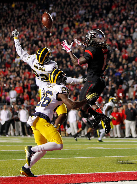 . Rutgers wide receiver Janarion Grant (1) can\'t make a catch in the end zone as Michigan\'s Jarrod Wilson (22) and Jourdan Lewis (26) defend during the second half of an NCAA college football game Saturday, Oct. 4, 2014, in Piscataway, N.J. Rutgers defeated Michigan 26-24. (AP Photo/Rich Schultz)