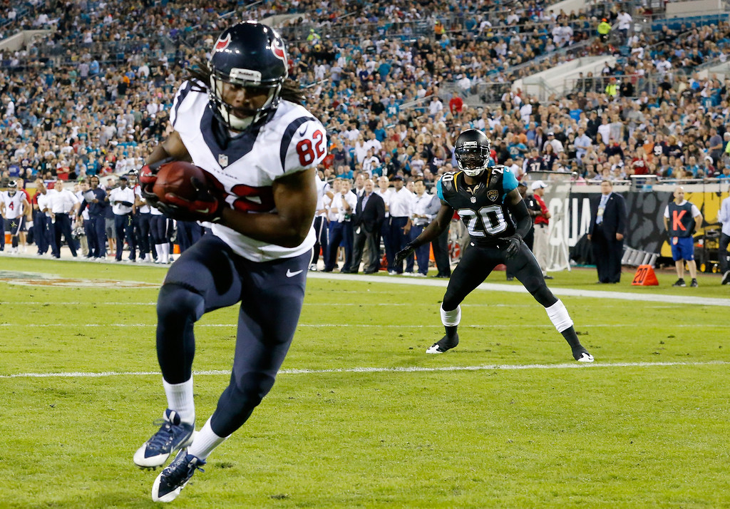 . Keshawn Martin #82 of the Houston Texans crosses the goal line for a touchdown during the game against the Jacksonville Jaguars at EverBank Field on December 5, 2013 in Jacksonville, Florida.  (Photo by Sam Greenwood/Getty Images)