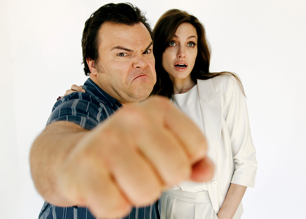 """. FILE - In this April 14, 2011 file photo, actors Angelina Jolie, right, and Jack Black, from the upcoming film \""""Kung Fu Panda 2\"""", pose for a portrait in Glendale, Calif. Jack Black told the world that Angelina Jolie was pregnant with twins three years ago, when their animated comedy \""""Kung Fu Panda\"""" played at the Cannes Film Festival. That did not stop Jolie from sending a lovely present to Black\'s own pregnant wife, Tanya Haden. (AP Photo/Matt Sayles, File)"""