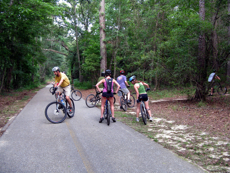 The leaders decide to head into Tom Brown Park's Magnolia Trail at trail marker #57.
