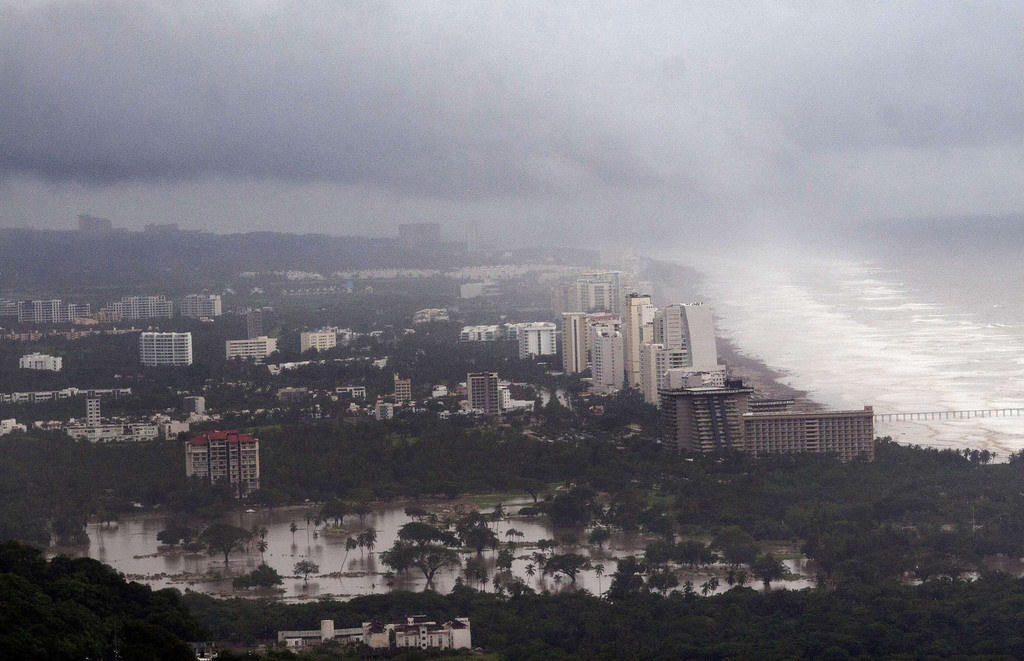 . View of the flooded area in Acapulco, Guerrero state, Mexico, after heavy rains hit the area on September 16, 2013. Hurricane Ingrid weakened to tropical storm strength as it made landfall on the northeastern coast in the morning while the Pacific coast was reeling from the remnants of Tropical Storm Manuel, which dissipated after striking on the eve. Thousands of people were evacuated on both sides of the country as the two storms set off landslides and floods that damaged bridges, roads and homes.   Pedro PARDO/AFP/Getty Images