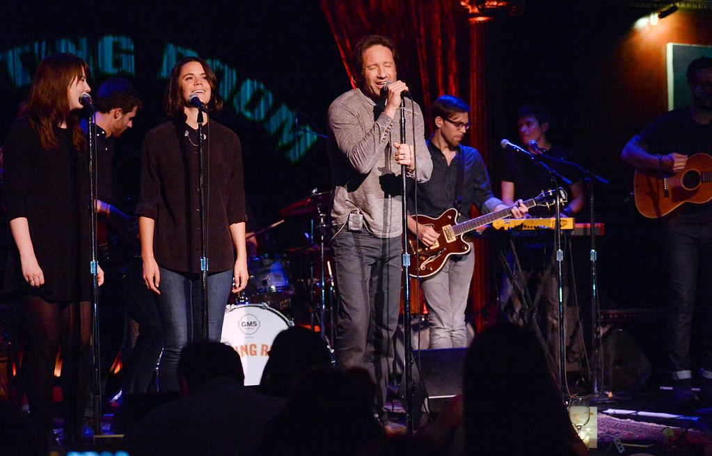 """. Actor and singer David Duchovny, center, performs at The Cutting Room, in support of the release of his debut album \""""Hell Or Highwater,\"""" on Tuesday, May 12, 2015, in New York. (Photo by Evan Agostini/Invision/AP)"""