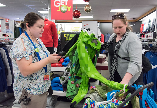 11/26/18 Wesley Bunnell | Staff Ashley Kelley of New Britain, R, has items price checked by Assistant Manager Melissa Hugel at Kohl's in Plainville on Monday afternoon.