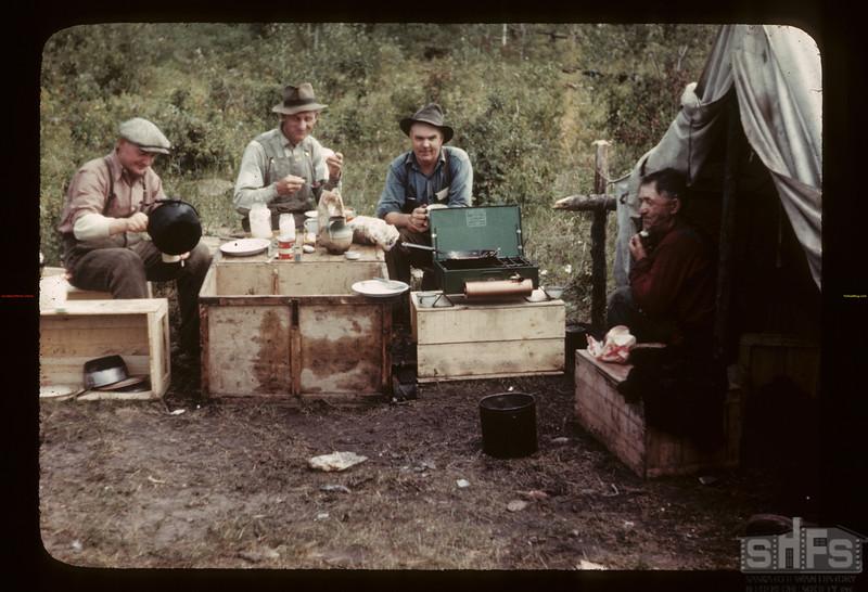 Fish camp diner - Island Lake; Art Anderson of Bluebell; Art Finskey of Meadow Lake; Gust Olson & Bill Leackwell. Goodsoil. 08/18/1945