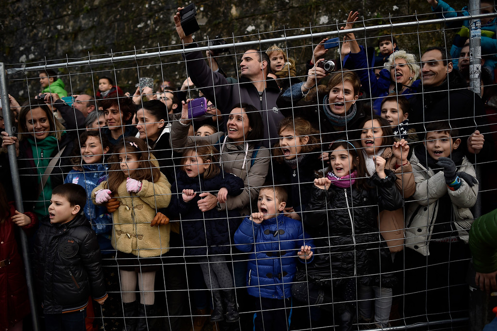 . People watch the Cabalgata Los Reyes Magos (Cavalcade of the three kings) the day before Epiphany, in Pamplona, northern Spain, Tuesday, Jan. 5, 2016. It is a parade symbolizing the coming of the Magi to Bethlehem following the birth of Jesus. In Spain and many Latin American countries Epiphany is the day when gifts are exchanged. (AP Photo/Alvaro Barrientos)