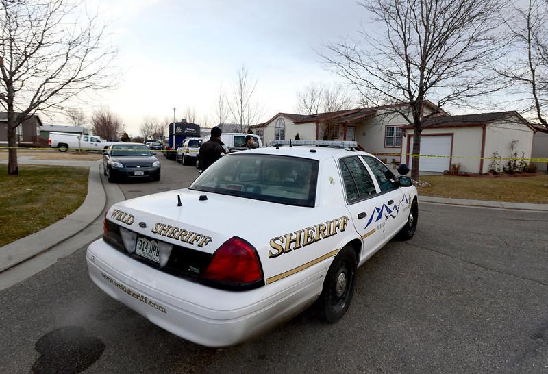 . Weld County Sheriffs deputies and Longmont Police investigate the scene, Tuesday, Dec. 18, 2012, in Longmont. (Matthew Jonas/Times-Call)