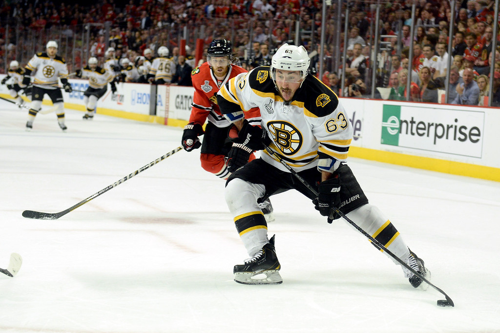 . CHICAGO, IL - JUNE 22:  Brad Marchand #63 of the Boston Bruins controls the puck against the Chicago Blackhawks in Game Five of the 2013 NHL Stanley Cup Final at United Center on June 22, 2013 in Chicago, Illinois.  (Photo by Harry How/Getty Images)
