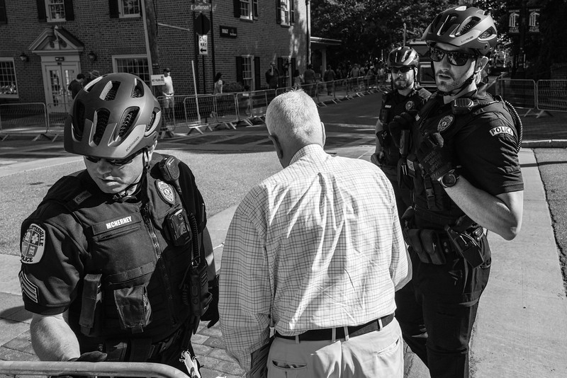Charolettesville Police allow an elderly gentleman through the barracde to cross the street to his home prior to the removal of the Stonewall Jackson statue