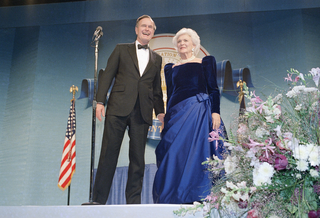 . U.S. President George Bush and Mrs. Barbara Bush attend one of the Inaugural Balls, Friday, Jan. 21, 1989, night at the D.C Armory in Washington. (AP Photo/J. Scott Applewhite)