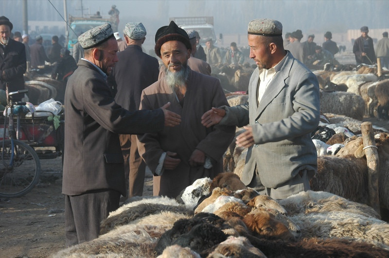 Kashgar Animal Market: Bargaining for Goats -China