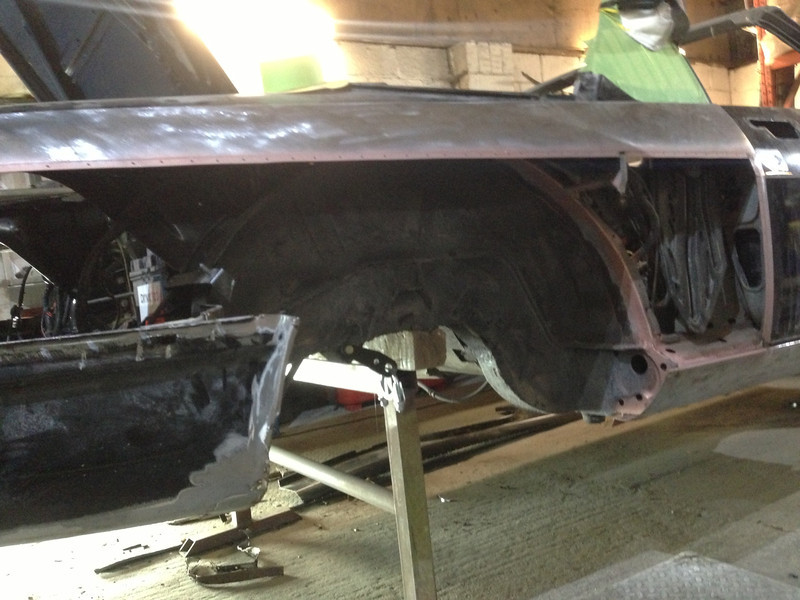 The inner wheel arch comprises two section, and the outer of those two has had to be cut away due to rust.