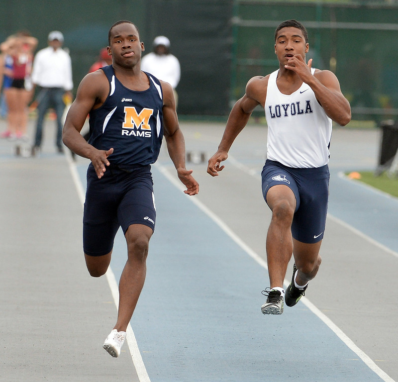. Millikan\'s Malik Brown, left, along with Loyola\'s Nico Evans competes in the division 1 100 meter dash during the CIF Southern Section track and final Championships at Cerritos College in Norwalk, Calif., Saturday, May 24, 2014.   (Keith Birmingham/Pasadena Star-News)