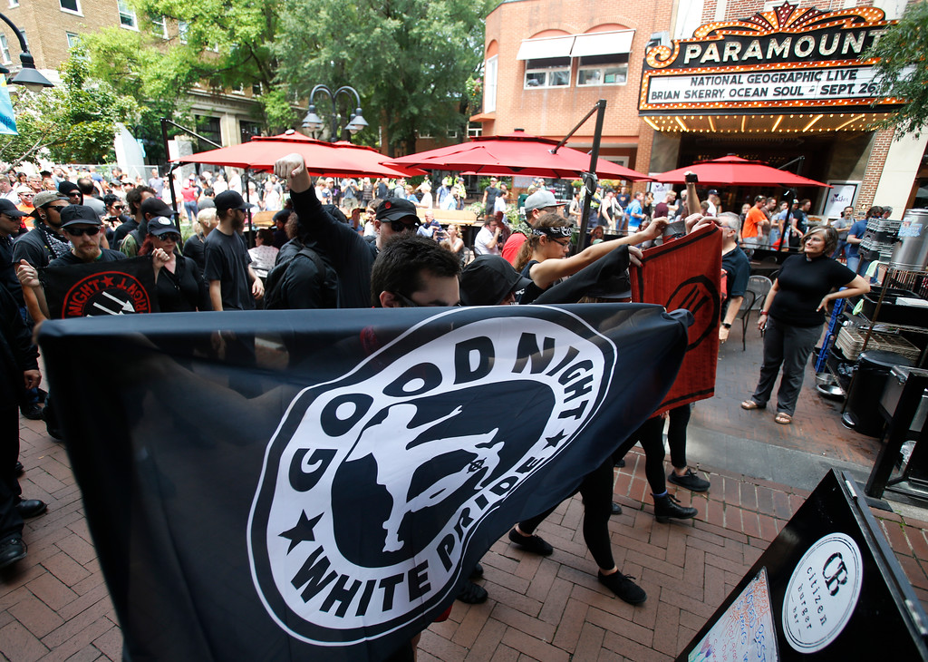 . A group Anti-fascism demonstrators, march in the downtown area in anticipation of the anniversary of last year\'s Unite the Right rally in Charlottesville, Va., Saturday, Aug. 11, 2018. (AP Photo/Steve Helber)