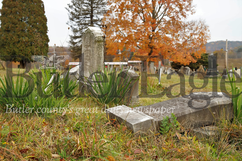 Fallen overgrown tombstones in the Harmony Mennonite Meetinghouse Cemetery. Seb Foltz/Butler Eagle