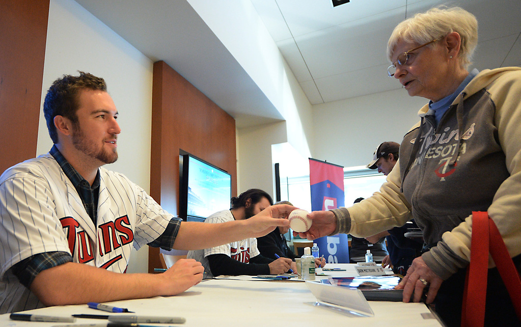 . Twins fan Dorothy Foster from Minneapolis gets a baseball signed by new Twins pitcher Phil Hughes while attending Twinsfest at Target Field, Saturday, January 25, 2014(Pioneer Press: John Autey)
