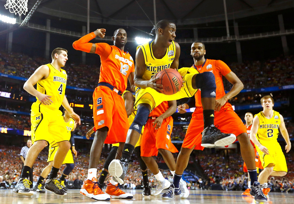. Michigan Wolverines guard Caris LeVert (23) pulls in a rebound against the Syracuse Orange in the first half of their NCAA men\'s Final Four basketball game in Atlanta, Georgia April 6, 2013. REUTERS/Jeff Haynes
