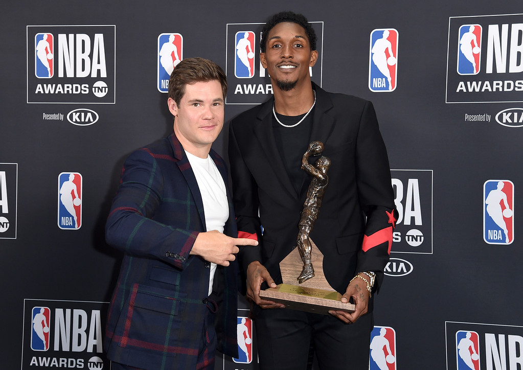 . Adam Devine, left, and Lou Williams, of the Los Angeles Clippers, winner of the 6th Man award, pose in the press room at the NBA Awards on Monday, June 25, 2018, at the Barker Hangar in Santa Monica, Calif. (Photo by Richard Shotwell/Invision/AP)