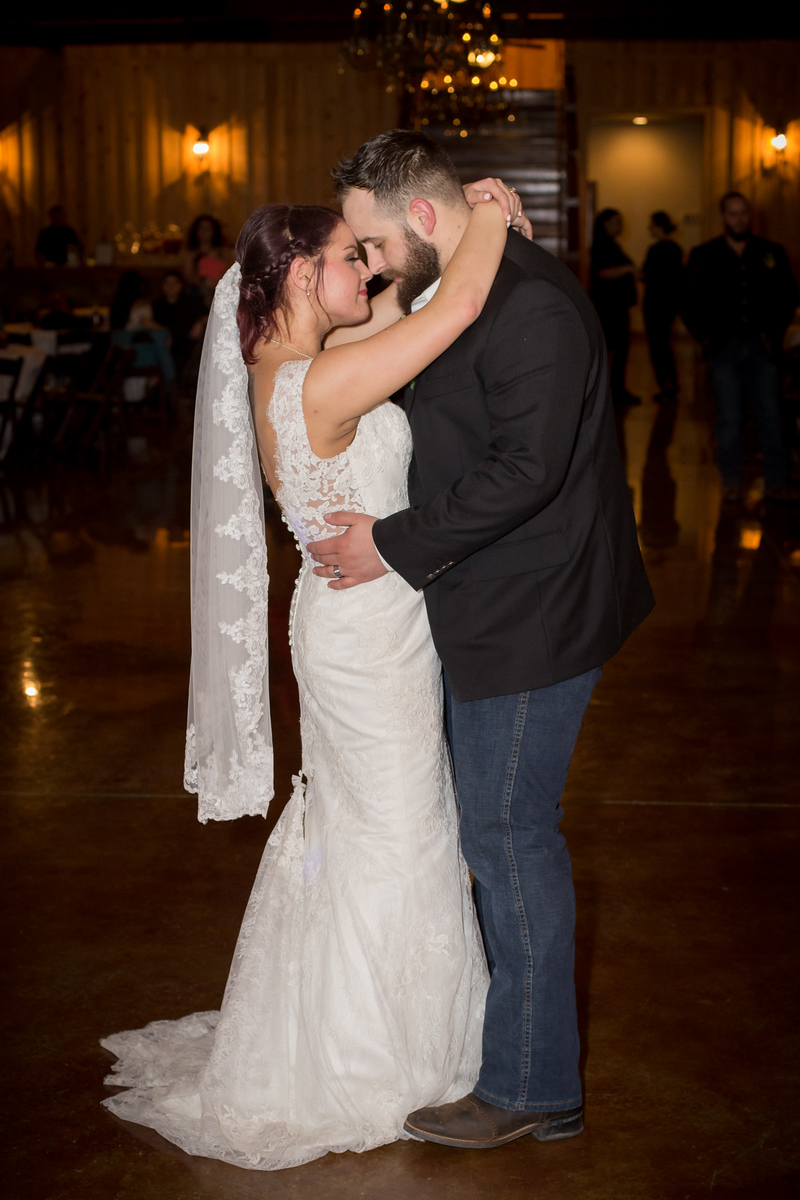a newlywed couple during their first dance