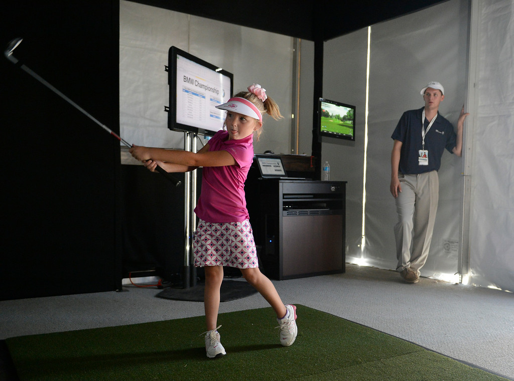 . CHERRY HILLS VILLAGE, CO. - SEPTEMBER 02:  Young golfer, Haylee Clark, 7, from Aurora Colorado, hits an iron shot at the BMW Experience, Fan Challenge tent set up at the FedExCup BMW Championship at the Cherry Hills Country Club Tuesday, September 02, 2014 (Photo By Andy Cross / The Denver Post)