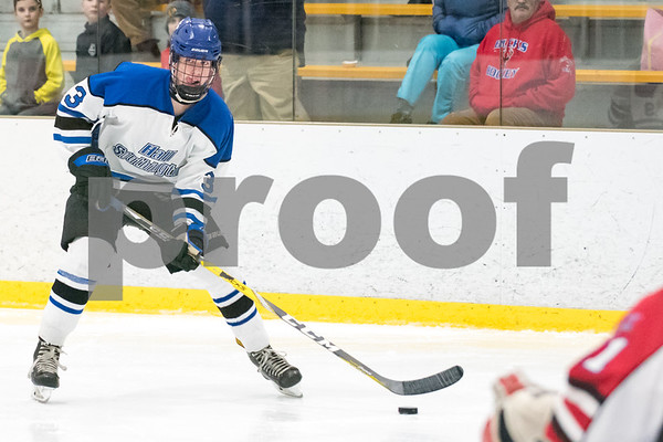 03/01/18 Wesley Bunnell | Staff Hall-Southington defeated EO Smith-Tolland 4-3 in the CCC South semi-final game on Thursday at Veterans Memorial Rink in West Hartford. Graham Kennedy (3) looks to pass the puck .