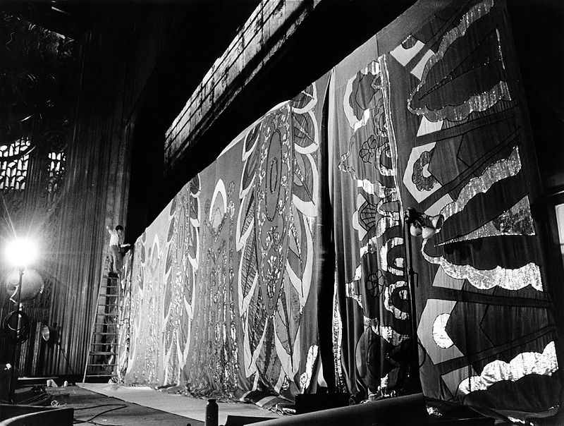 ". Workers in August 1973 hang an exact duplicate of the gold, silver and green curtain first used at the Paramount Theatre in Oakland in May 1932 for Al Jolson\'s ""Wonder Bar Review.\"" (Leo Cohen/Bay Area News Group Staff Archives)"