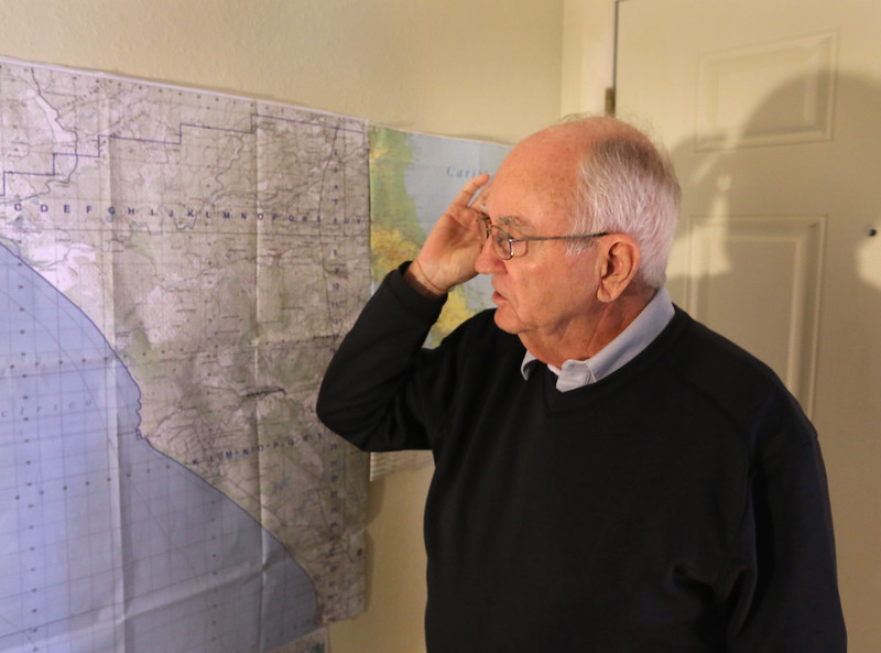 Bob Jackman studies maps of Nicaragua at his south Tulsa home.