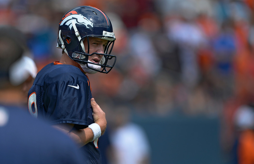. Denver Broncos quarterback Peyton Manning (18) prepares for day four of the Denver Broncos 2014 training camp July 27, 2014 at Sports Authority Field at Mile High. (Photo by John Leyba/The Denver Post)