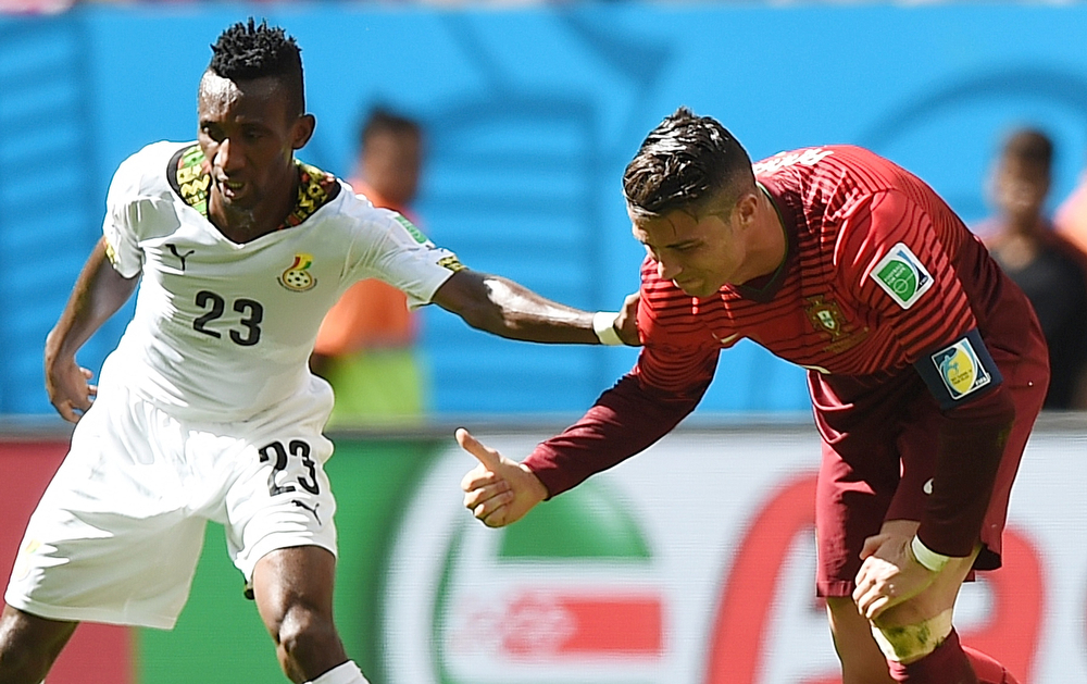 . Ghana\'s defender Harrison Afful (L) gestures to Portugal\'s forward and captain Cristiano Ronaldo during the Group G football match between Portugal and Ghana at the Mane Garrincha National Stadium in Brasilia during the 2014 FIFA World Cup on June 26, 2014. (FRANCISCO LEONG/AFP/Getty Images)
