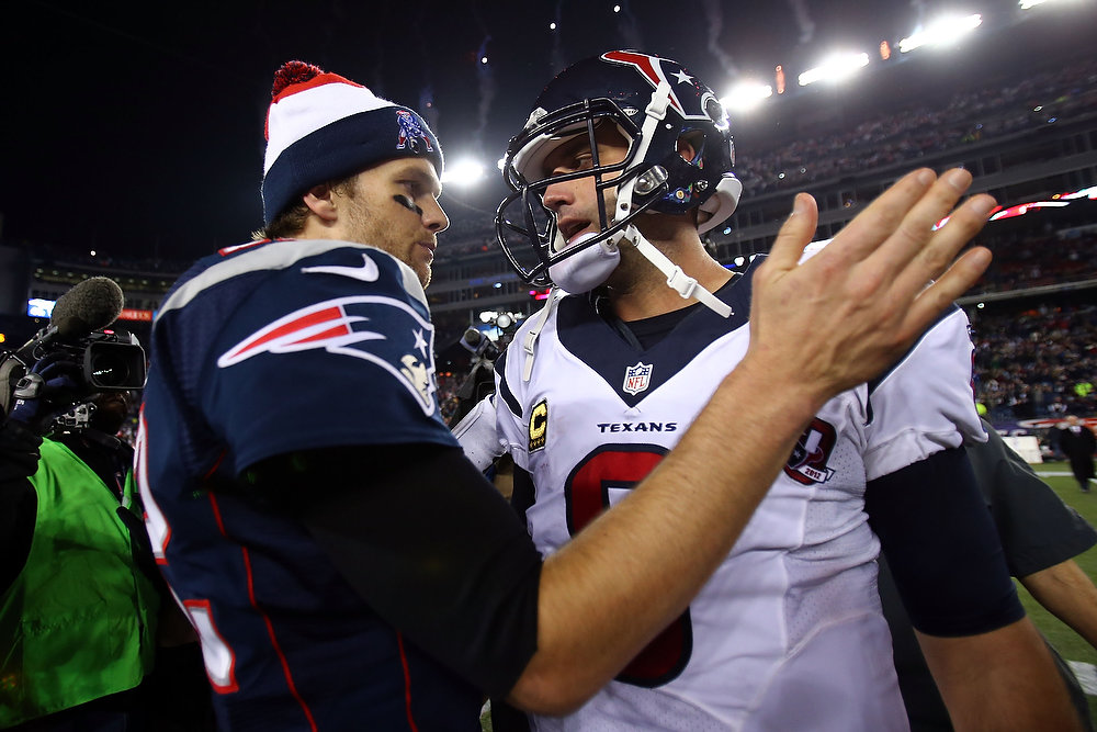 Description of . Tom Brady #12 of the New England Patriots greets Matt Schaub #8 of the Houston Texans after the 2013 AFC Divisional Playoffs game at Gillette Stadium on January 13, 2013 in Foxboro, Massachusetts.  (Photo by Elsa/Getty Images)