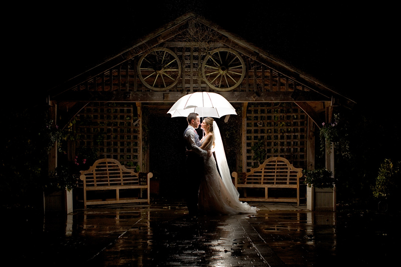 wedding-photographer-rain-umbrella-maidensbarn-essex-(64).jpg