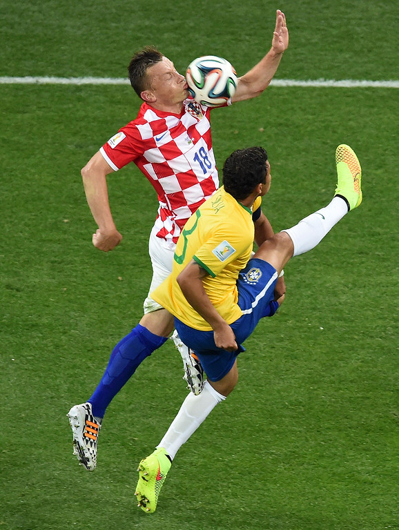 . Brazil\'s defender and captain Thiago Silva (R) is challenged for the ball by Croatia\'s forward Ivica Olic during the Group A football match between Brazil and Croatia at the Corinthians Arena in Sao Paulo on June 12, 2014, during the 2014 FIFA World Cup.      AFP PHOTO / FRANCOIS XAVIER MARIT/AFP/Getty Images