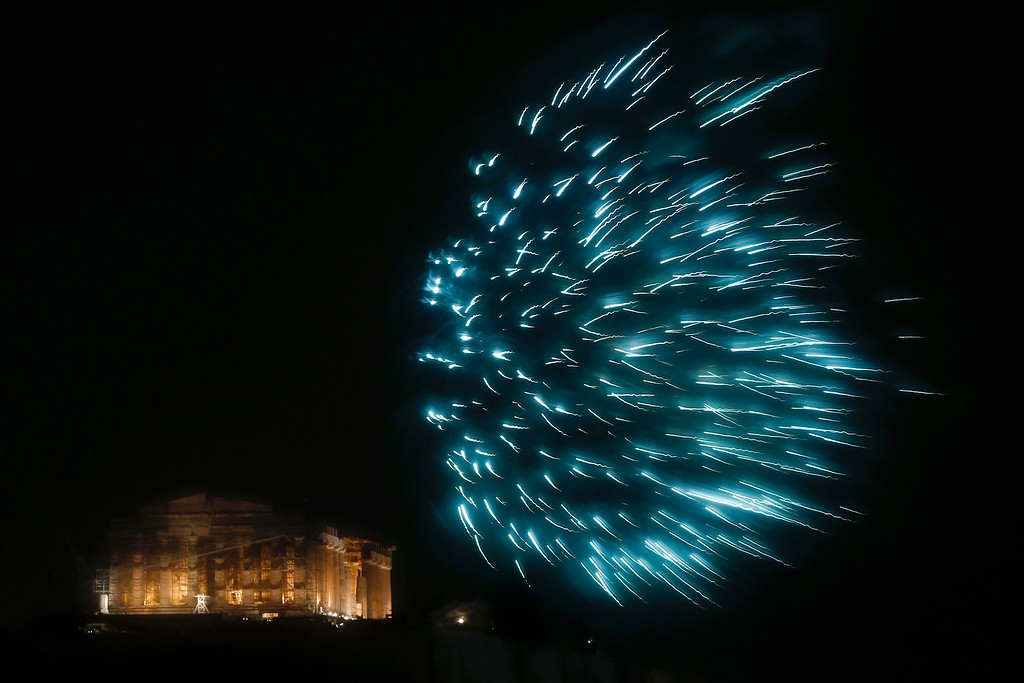 . Fireworks explode over the ancient Parthenon temple at the Acropolis hill for the the New Year\'s Eve celebrations during a rainfall in Athens, on Thursday, Jan.1, 2015.(AP Photo/Petros Giannakouris)