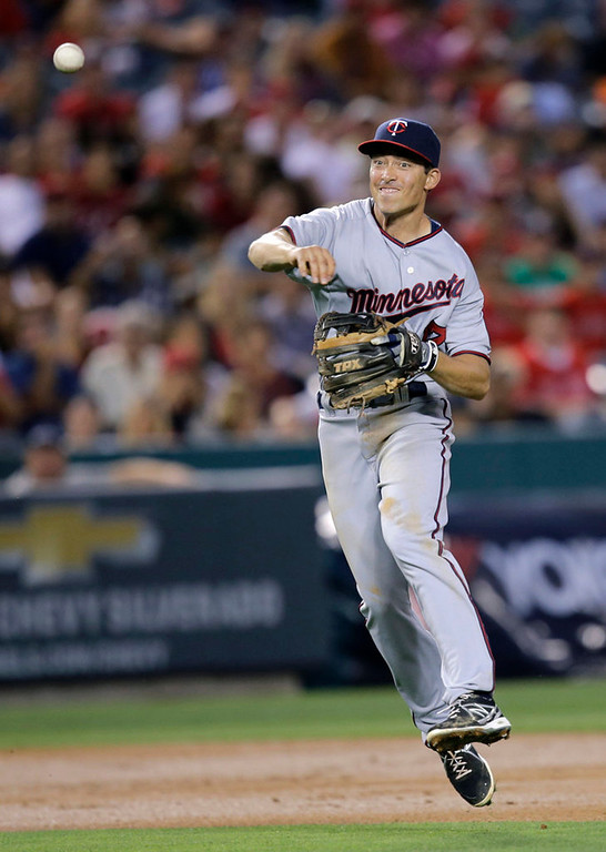 . Minnesota Twins second baseman Doug Bernier throws to first base after fielding a ball hit by Los Angeles Angels\' J.B. Shuck during the third inning of a baseball game on Monday, July 22, 2013, in Anaheim, Calif. Shuck was out at first. (AP Photo/Jae C. Hong)
