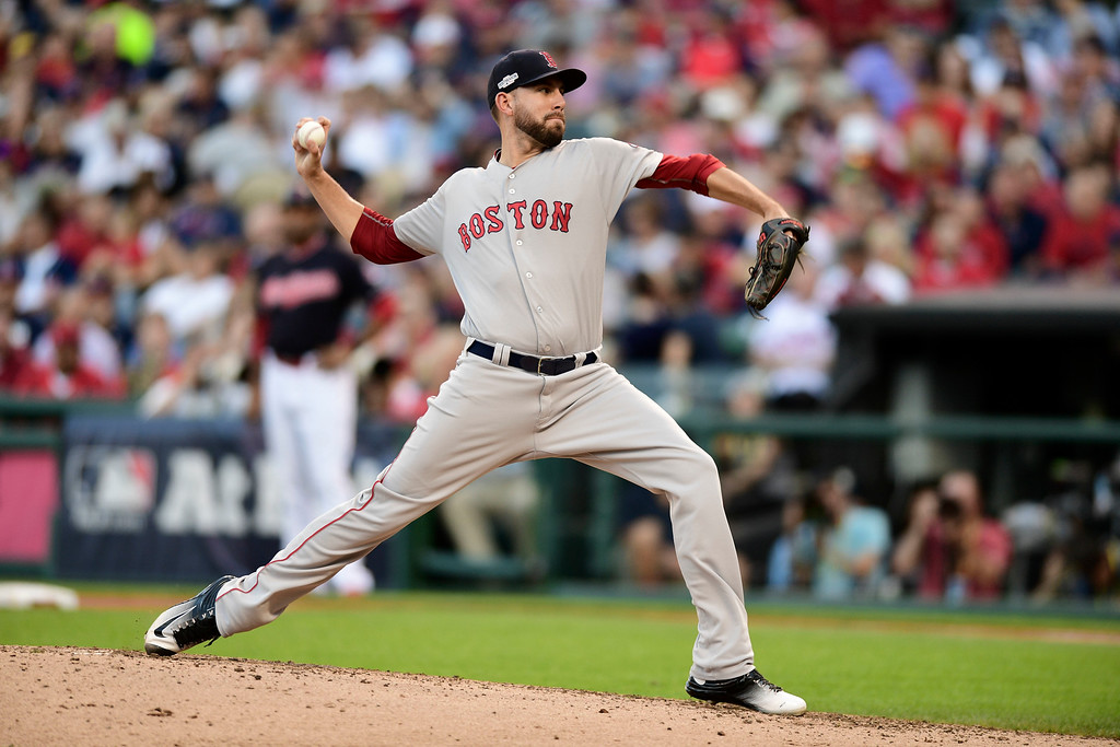. Boston Red Sox relief pitcher Matt Barnes throws against the Cleveland Indians in the fourth inning during Game 2 of baseball\'s American League Division Series, Friday, Oct. 7, 2016, in Cleveland. (AP Photo/David Dermer)