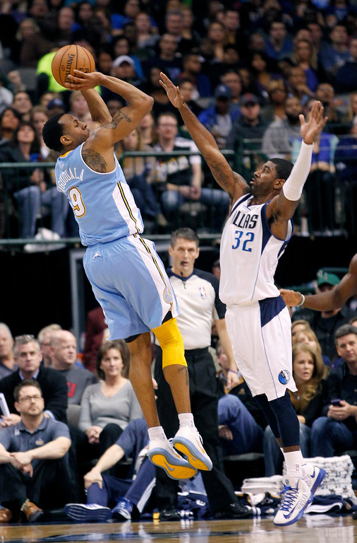 . Denver Nuggets guard Andre Iguodala shoots against Dallas Mavericks guard O.J. Mayo during the first half of their NBA basketball game in Dallas, Texas December 28, 2012.  REUTERS/Mike Stone (UNITED STATES - Tags: SPORT BASKETBALL)