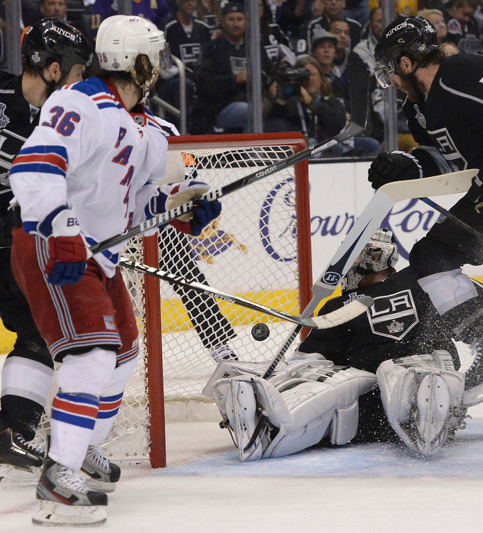 . Rangers#36 Mats Zuccarello wates the puck go past Kings#32 Jonathan Quick after he assisted Rangers#16 Derick Brassard in the second period.  The Los Angeles Kings faced the New York Rangers in game 2 of the Stanley Cup Final.  Los Angeles, CA. 6/7/2014(Photo by John McCoy Daily News)
