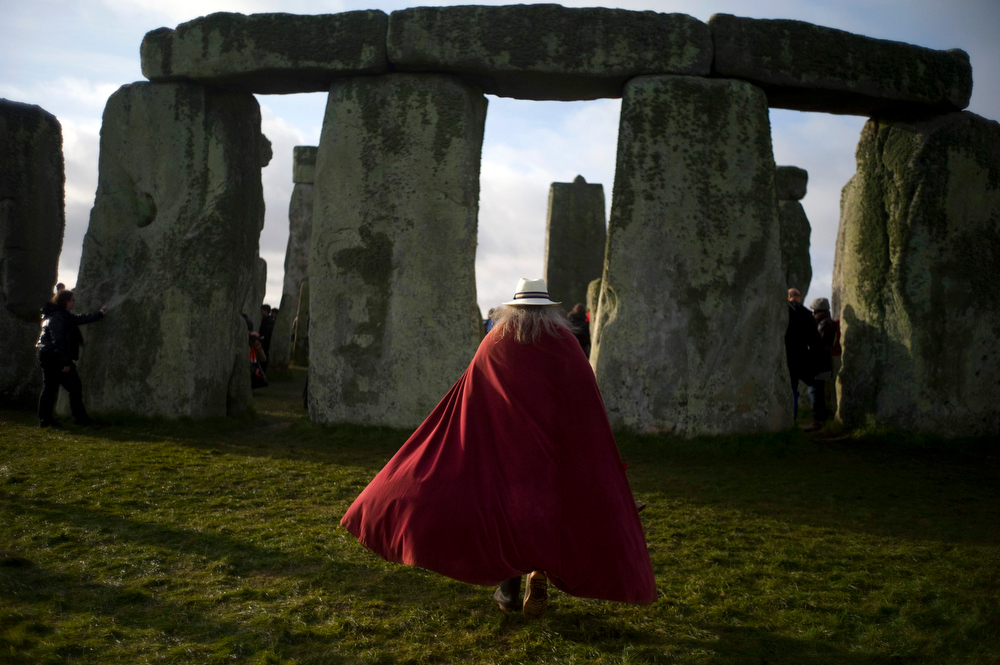 Description of . A druid walks through the stones during the winter solstice at Stonehenge on Salisbury plain in southern England December 21, 2012. The winter solstice is the shortest day of the year, and the longest night of the year. REUTERS/Kieran Doherty