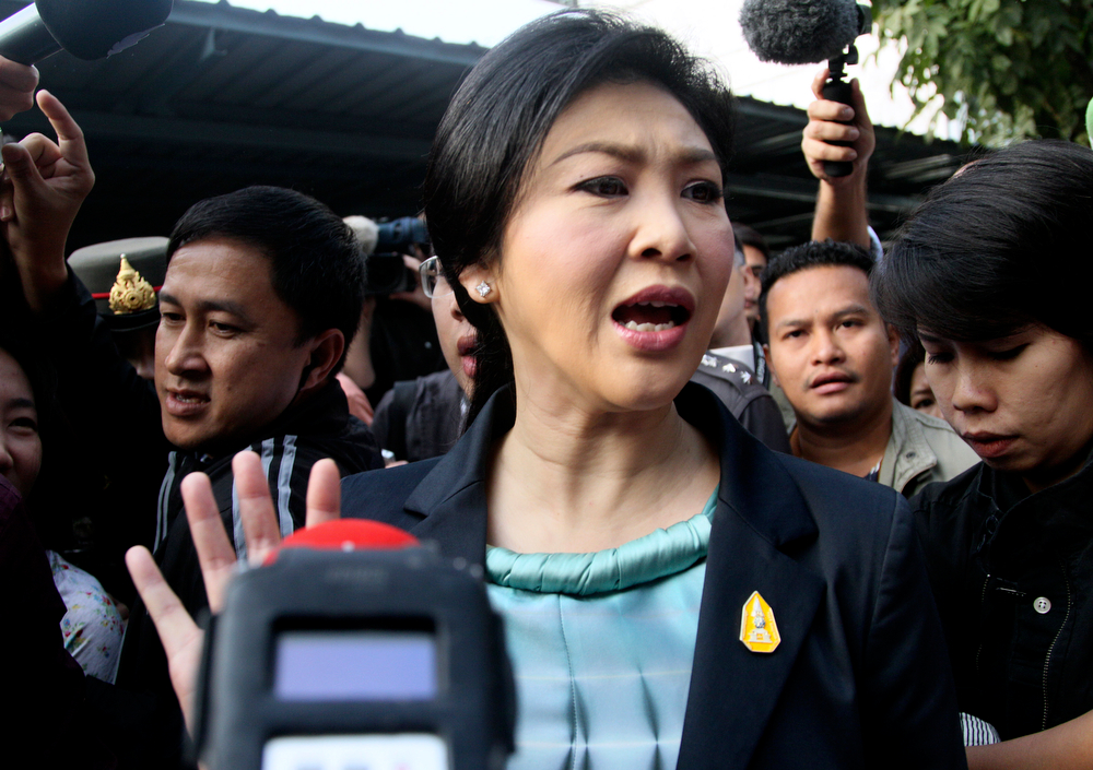 . Thai Prime Minister Yingluck Shinawatra leaves a polling station after casting her ballot for the general election in Bangkok, Thailand, Sunday, Feb. 2, 2014. (AP Photo/Sakchai Lalit)