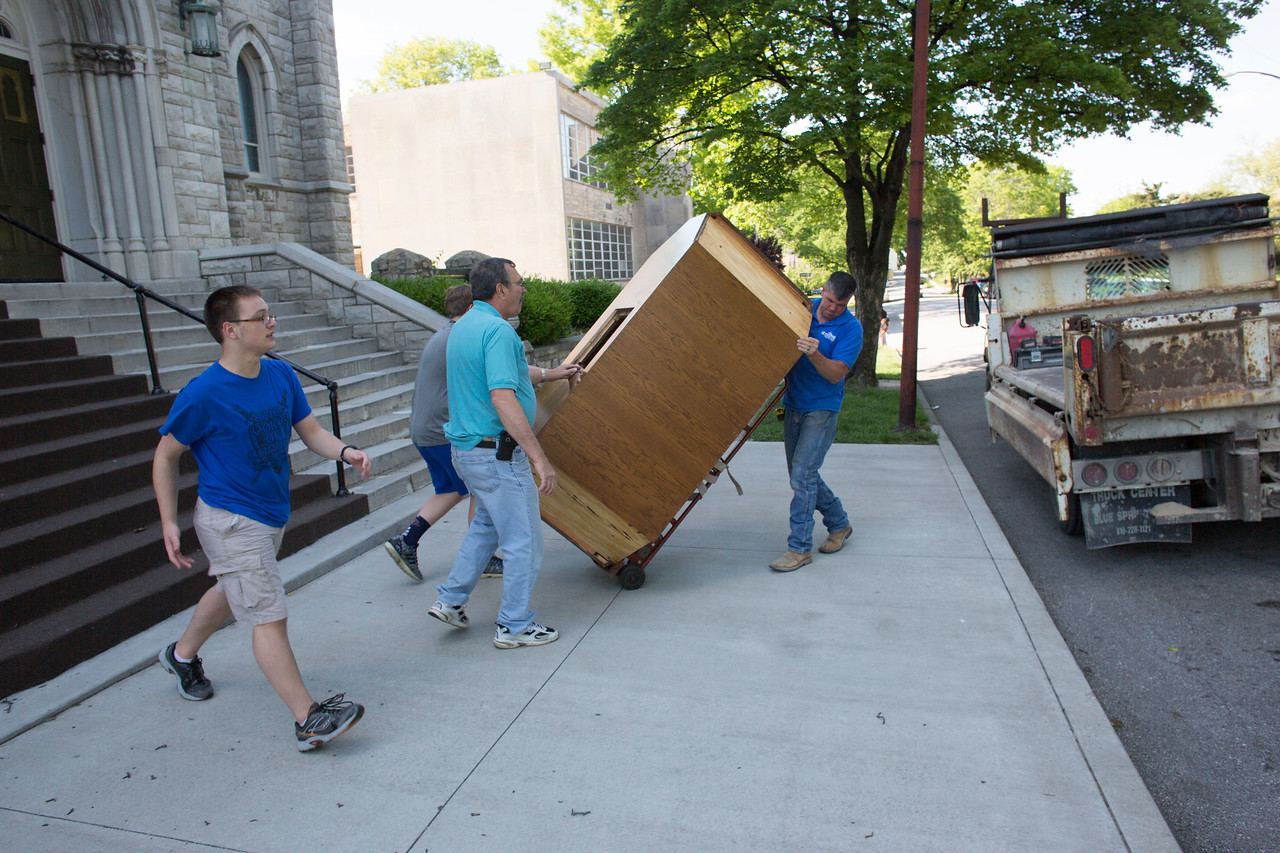 Andy Kelly takes the brunt of the altar, while Mike Hinkle (middle) and Ian Kelly (grey) and Josh Hinkle, help.