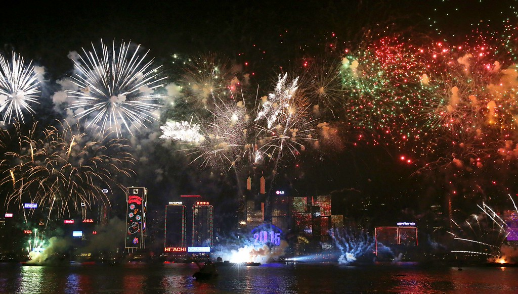 . Fireworks explode over Victoria Harbour in Hong Kong on January 1, 2015. Just like previous years, the city\'s iconic skyline along Victoria Harbour will light up with an eight-minute pyrotechnic display, as tens of thousdands of partygoers will flock to the waterfront to celebrate.    AFP PHOTO / ISAAC LAWRENCEIsaac Lawrence/AFP/Getty Images
