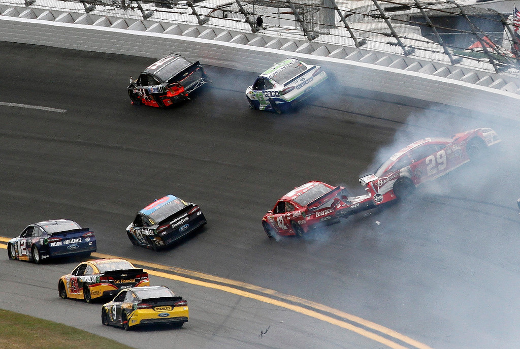 . Juan Pablo Montoya (42) and Kevin Harvick (29) get tangled up going in to turn 1 after a multi-car crash started on the front stretch in the NASCAR Daytona 500 Sprint Cup Series auto race at Daytona International Speedway, Sunday, Feb. 24, 2013, in Daytona Beach, Fla. (AP Photo/David Graham)